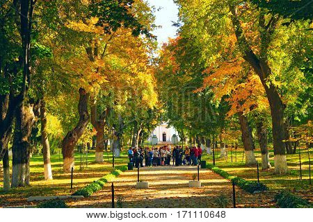 Kachanivka Chernihiv region / Ukraine. great autumnal park and crowd of people in excursion in historical estate of Kachanivka. 01 October 2016