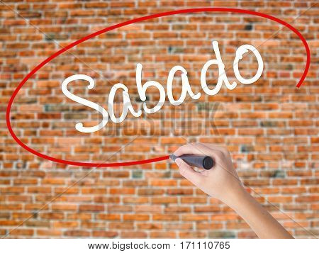 Woman Hand Writing Sabado (saturday In Spanish/portuguese) With Black Marker On Visual Screen