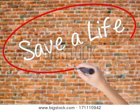 Woman Hand Writing Save A Life  With Black Marker On Visual Screen