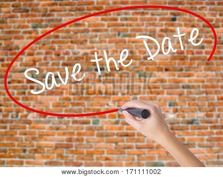 Woman Hand Writing Save The Date  With Black Marker On Visual Screen