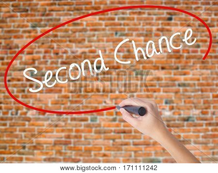 Woman Hand Writing Second Chance With Black Marker On Visual Screen