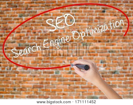Woman Hand Writing Seo Search Engine Optimization With Black Marker On Visual Screen