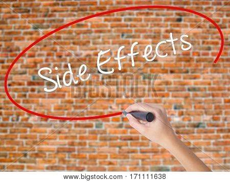 Woman Hand Writing Side Effects With Black Marker On Visual Screen