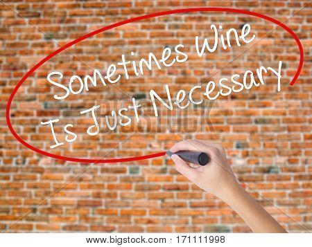 Woman Hand Writing Sometimes Wine Is Just Necessary With Black Marker On Visual Screen