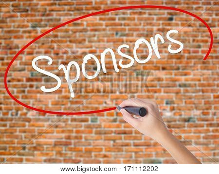 Woman Hand Writing Sponsors  With Black Marker On Visual Screen
