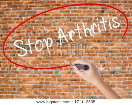 Woman Hand Writing Stop Arthritis With Black Marker On Visual Screen