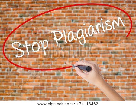 Woman Hand Writing Stop Plagiarism With Black Marker On Visual Screen