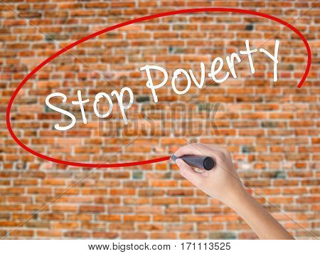 Woman Hand Writing Stop Poverty  With Black Marker On Visual Screen