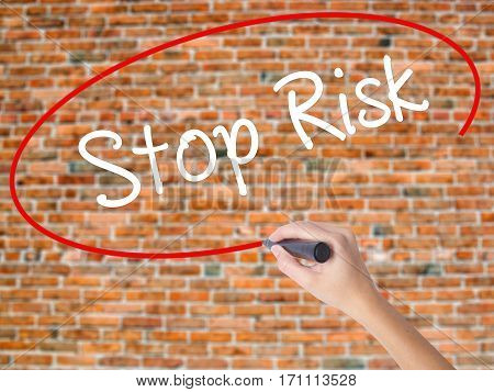 Woman Hand Writing Stop Risk With Black Marker On Visual Screen