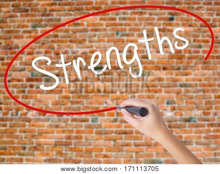 Woman Hand Writing Strengths With Black Marker On Visual Screen.