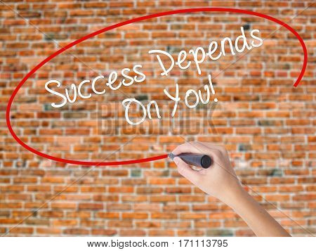 Woman Hand Writing Success Depends On You! With Black Marker On Visual Screen