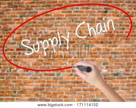 Woman Hand Writing Supply Chain With Black Marker On Visual Screen