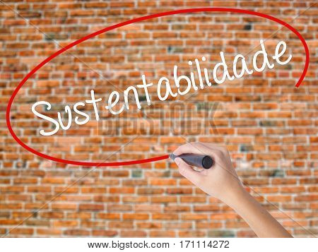 Woman Hand Writing Sustentabilidade (in Portuguese - Sustainability) With Black Marker On Visual Scr
