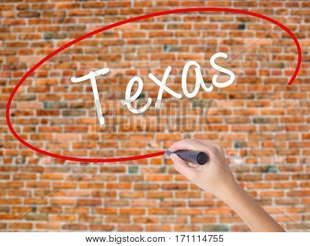Woman Hand Writing Texas  With Black Marker On Visual Screen
