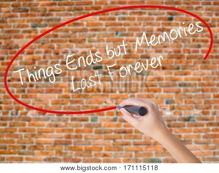 Woman Hand Writing Things Ends But Memories Last Forever With Black Marker On Visual Screen