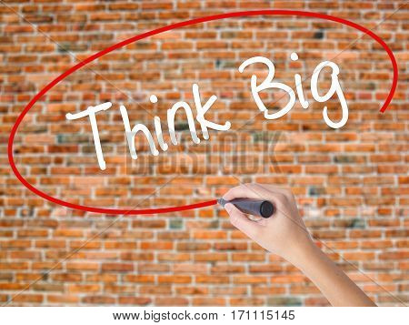 Woman Hand Writing Think Big With Black Marker On Visual Screen