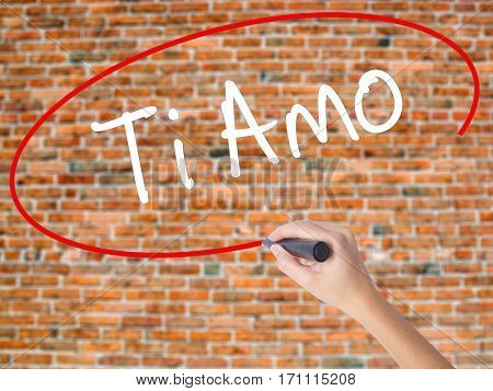 Woman Hand Writing Ti Amo (i Love You In Italian) With Black Marker On Visual Screen.