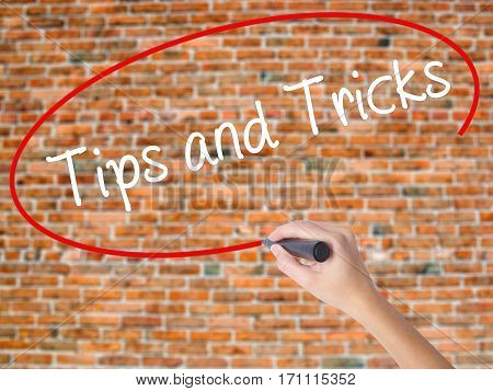 Woman Hand Writing Tips And Tricks With Black Marker On Visual Screen
