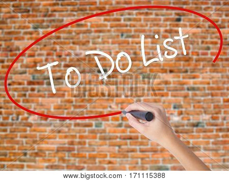 Woman Hand Writing To Do List With Black Marker On Visual Screen