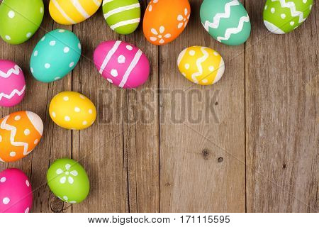 Colorful Easter Egg Corner Border Against A Rustic Wood Background