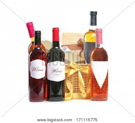 St. Valentines Day concept. Wine bottles and gift boxes in basket isolated on white