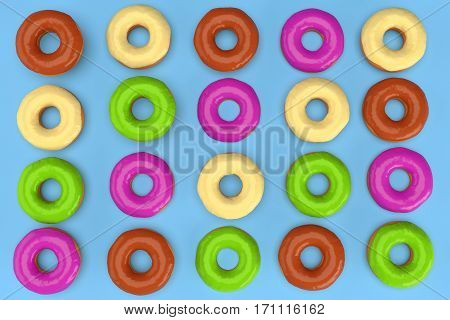 Colorful donuts on blue background. 3d rendering