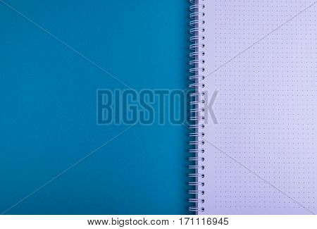 Notebook, blue background texture, empty for copyspace