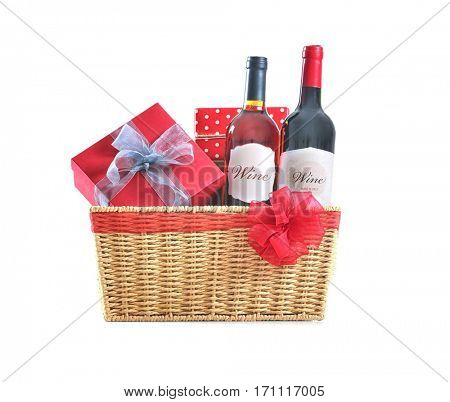 St. Valentines Day concept. Two wine bottles and gift boxes in basket isolated on white