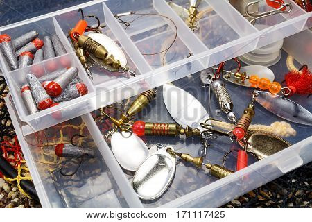 Storage box with fishing baits and accessories