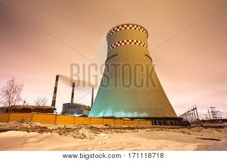 Thermal Power Plant And Cooling Towers At Night
