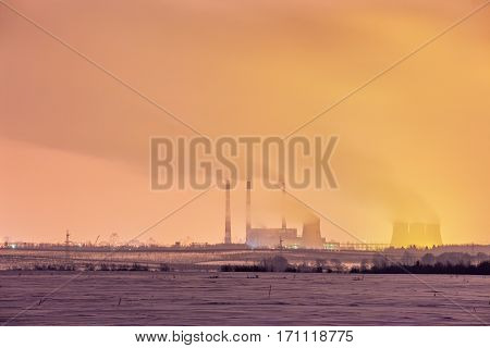 Power Plant And Cooling Towers At Dusk