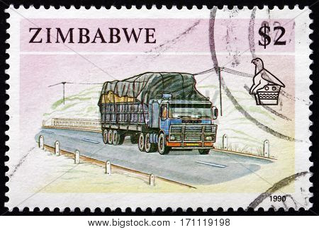 ZIMBABWE - CIRCA 1990: a stamp printed in Zimbabwe shows Tractor-trailer truck circa 1990