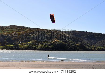 Kitesurfer on the water in Raglan New Zealand