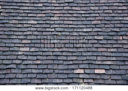 The house roof made from slate tiles