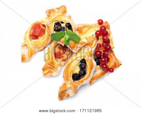 Tasty puff pastry with berries on white background
