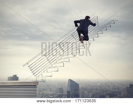Businessman drawing a rising scale. Concept of career of a businessman