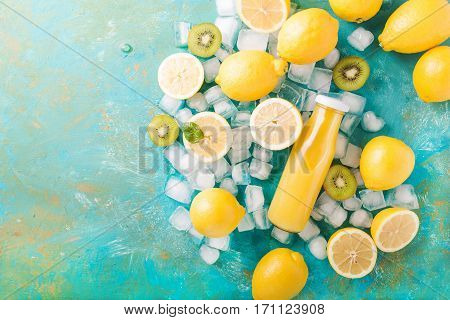 Orange juice. Orange smoothie. Kiwi. Cocktails. Detox Juice. Summer drink. Healthy food concept. Orange juice in a glass bottle. Smoothie in a glass bottle on a turquoise background.