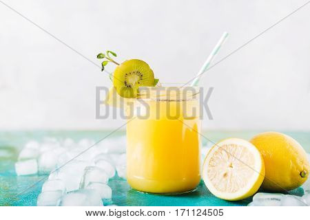 Orange juice. Orange smoothie on a turquoise background. Kiwi. Cocktails. Detox Juice. Summer drink. Healthy food concept