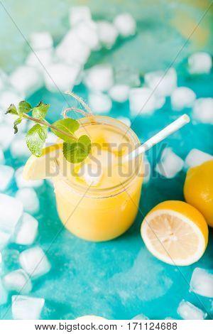 Orange juice. Orange smoothie on a turquoise background. Kiwi. Cocktails. Detox Juice. Summer drink. Healthy food concept