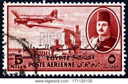 EGYPT - CIRCA 1947: a stamp printed in Egypt shows King Farouk Delta Dam and DC-3 Plane circa 1947
