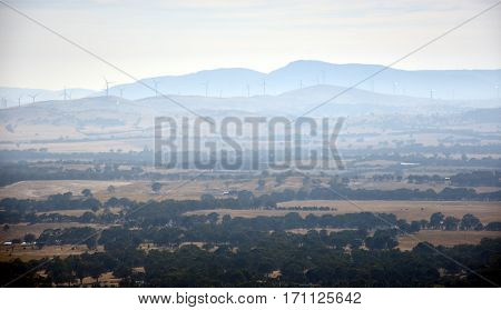 Broad panorama of the countryside in Western District of Victoria. View of huge wind turbines windmills. Early morning View from One Tree Hill Lookout (Ararat VIC Australia).