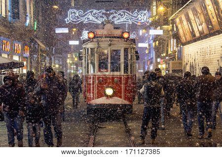ISTANBUL TURKEY - DECEMBER 30 2015: Snowstorm over a tram on Istiklal street main pedestrian street of Istanbul Turkey