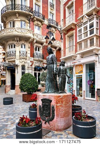 Cartagena Spain - January 29 2017: View to the Gran Hotel and bronze statues on the square of San Sebastian in Cartagena city. Spain