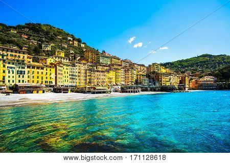 Camogli beach and typical colorful houses. Travel destination Ligury Italy Europe.