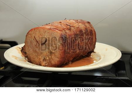 Piece of roasted pork with juicy gravy