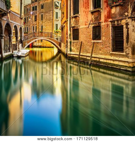 Venice sunset cityscape bridge water canal and traditional buildings. Italy Europe. Long exposure