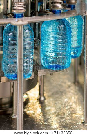 Filling pure bottles with mineral water at a factory