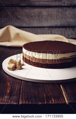 Delicious Three-layer Chocolate Cake Stands On A Circular Base