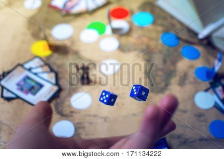 Hand Throws The Dice On Background World Map Board Games