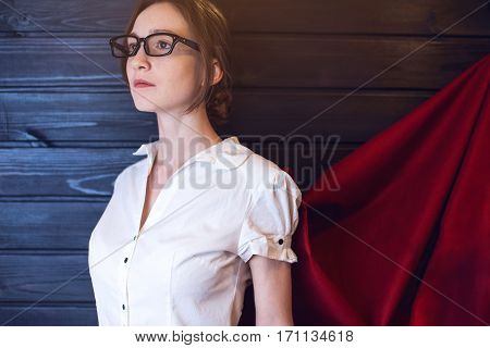 Office Worker Standing In A Suit And Red Cloak